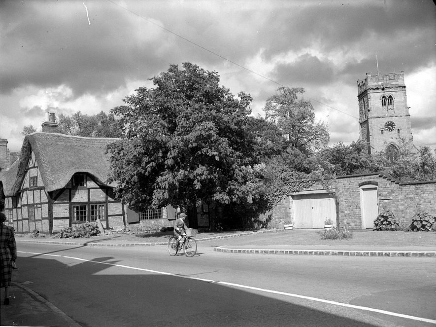 View of thatched cottage and church, Dunchurch.  1955 |  IMAGE LOCATION: (Warwickshire County Record Office)