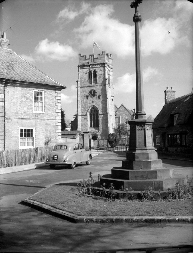 Dunchurch village cross with the church in the background.  1959 |  IMAGE LOCATION: (Warwickshire County Record Office)