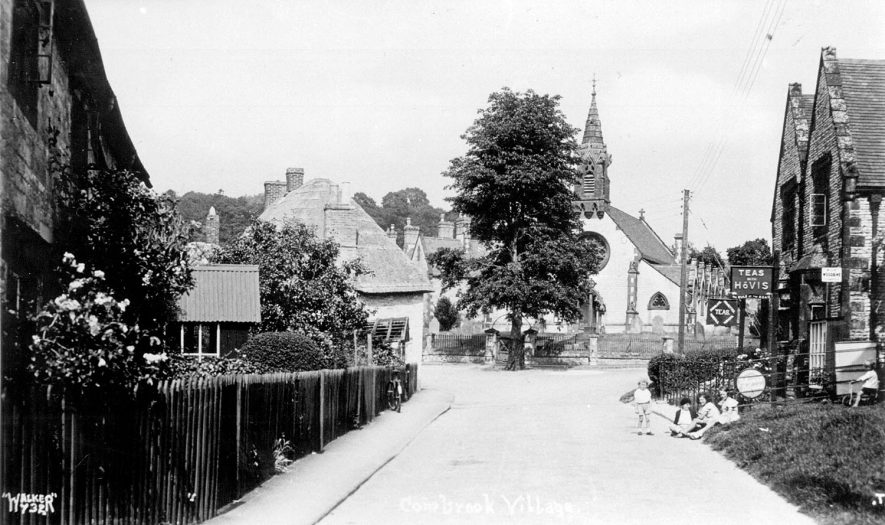 Part of village showing cottages, shop, cafe and chapel, Combrook. Children sitting at road side.  1920s |  IMAGE LOCATION: (Warwickshire County Record Office)