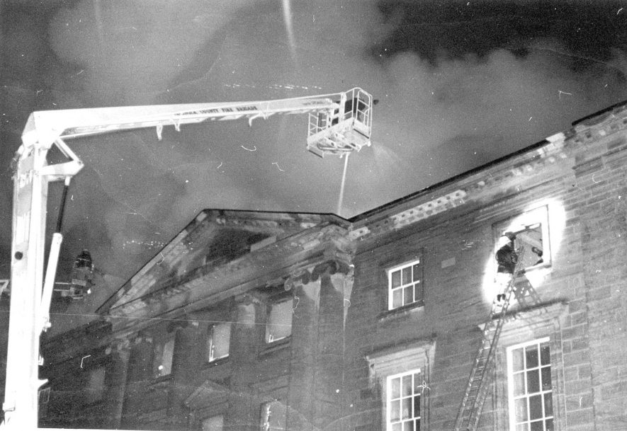 Fire at Packington Hall, Great Packington, showing fire engine crane and firemen.  1979. |  IMAGE LOCATION: (Warwickshire County Record Office)