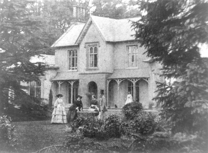 Ingon Grange, Snitterfield, showing ladies and gentleman in the garden.  1860s |  IMAGE LOCATION: (Warwickshire County Record Office)