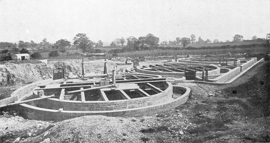 Hartshill sewage works under construction. This photograph is taken from the Coronation souvenir programme for Nuneaton, Attleborough, Stockingford and Galley Common.  1902 |  IMAGE LOCATION: (Warwickshire County Record Office)