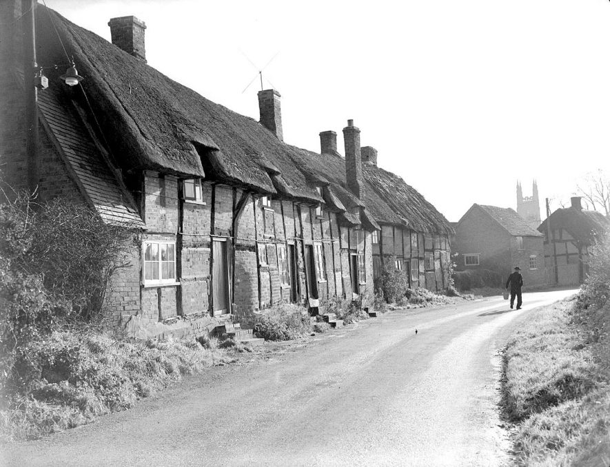Row of timbered, thatched cottages in Hampton Lucy.  December 1st 1954 |  IMAGE LOCATION: (Warwickshire County Record Office)