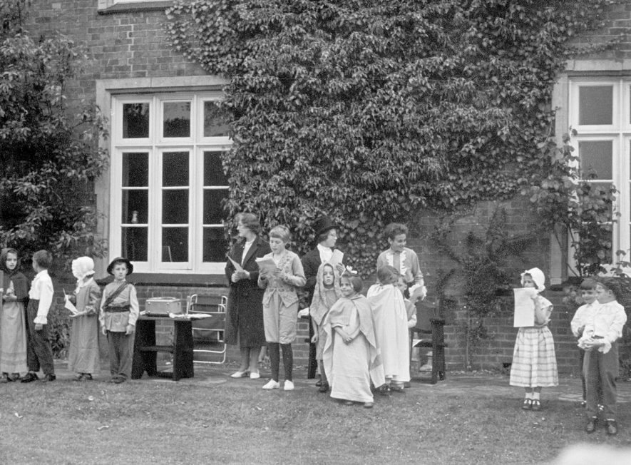 A pageant being performed in the grounds of the old vicarage, Grandborough.  1962 Left to right: R. Paget, R. Holland, C. Campion, R. Campion, L. Slade, J. Chapman, C. Whitney, C. Paget, B. Timms, T. Fletcher.  July 1962.    IMAGE LOCATION: (Warwickshire County Record Office) PEOPLE IN PHOTO: Witney, C, Witney as a surname, Timms, B, Timms as a surname, Slade, L, Paget, R, Paget, C, Paget as a surname, Holland, R, Holland as a surname, Fletcher, T, Fletcher as a surname, Chapman, J, Chapman as a surname, Campion, R, Campion, C, Campion as a surname