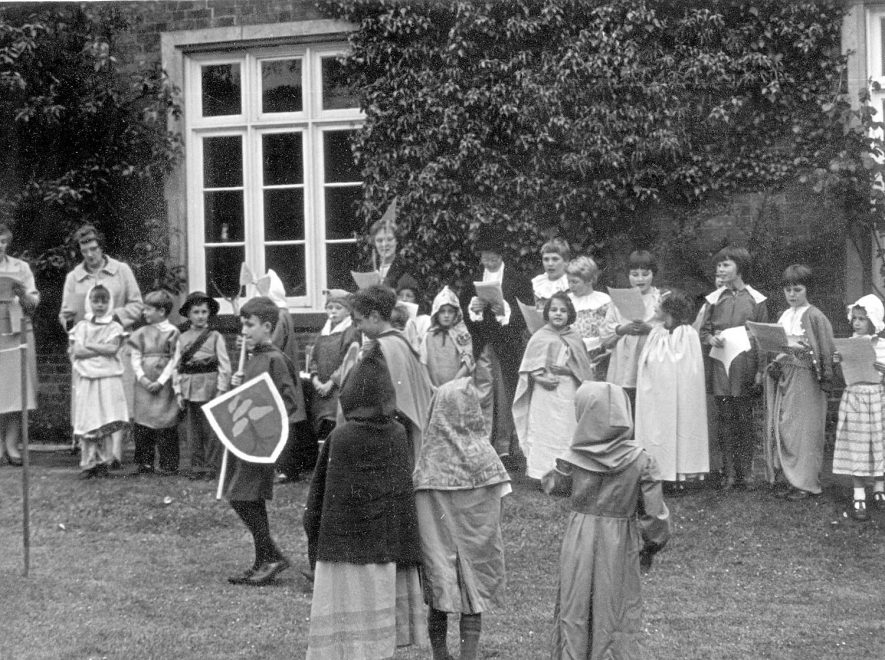 A pageant being performed in the grounds of the old vicarage, Grandborough.  1962  July 1962. |  IMAGE LOCATION: (Warwickshire County Record Office)