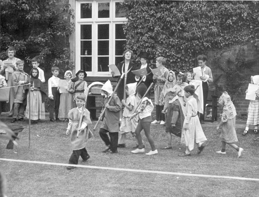A pageant being performed in the grounds of the old vicarage, Grandborough.  The children seen walking are, left to right: P. Graham, P. Timms, P. Dunkley, T. Dunkley, N. Cole, S. Dingley and C. Whitney.  July 1962 |  IMAGE LOCATION: (Warwickshire County Record Office)