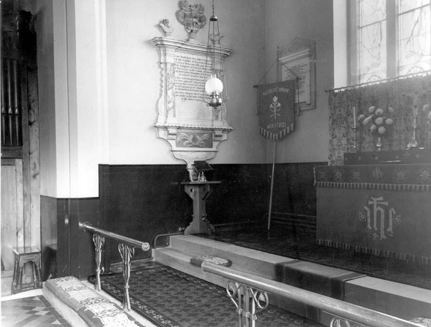 Great Wolford Parish Church, interior view of east end.  1960s |  IMAGE LOCATION: (Warwickshire County Record Office)