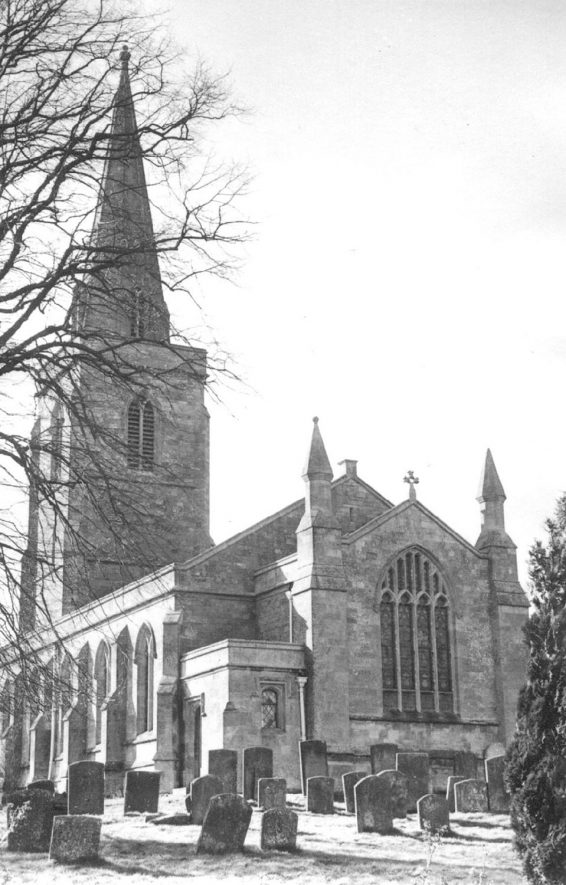 Great Wolford parish church, east end, tower and part of churchyard.  c.1973 |  IMAGE LOCATION: (Warwickshire County Record Office) IMAGE DATE: (c.1973)