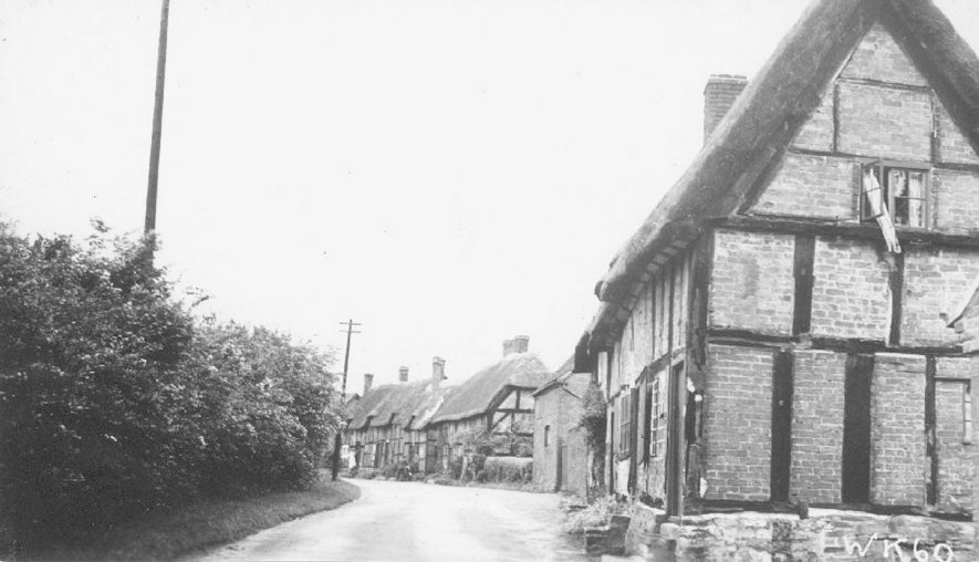 Thatched and timbered cottages, Hampton Lucy.  June 27th 1938 |  IMAGE LOCATION: (Warwickshire County Record Office)