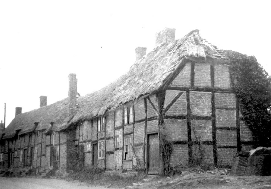 Thatched and timbered cottages in Hampton Lucy, prior to their demolition.  1950s |  IMAGE LOCATION: (Warwickshire County Record Office)