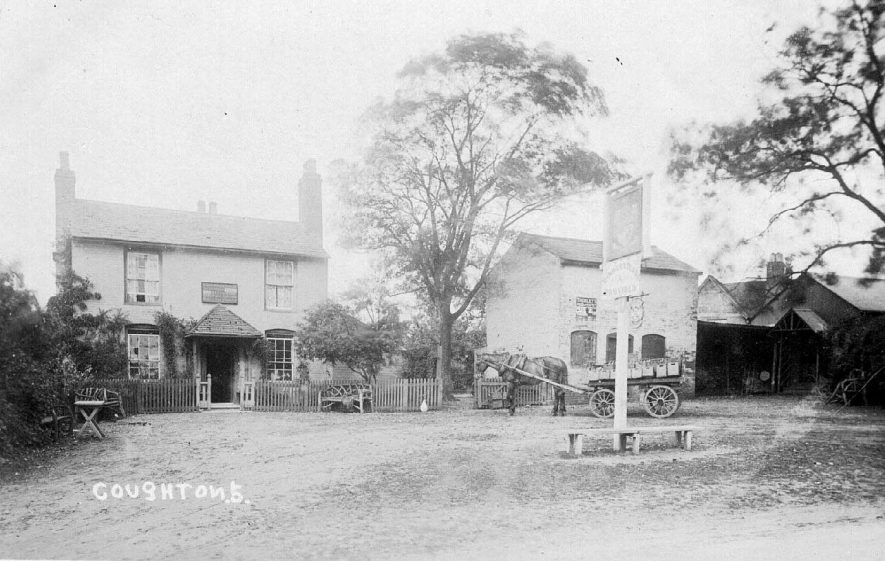 Horse and cart delivering bottles to the Throckmorton Arms public house in Coughton. The sign outside reads