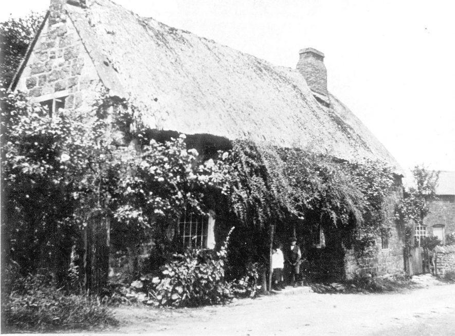 Two cottages in Back street, which have now been demolished, Ilmington.  1920 |  IMAGE LOCATION: (Warwickshire County Record Office)