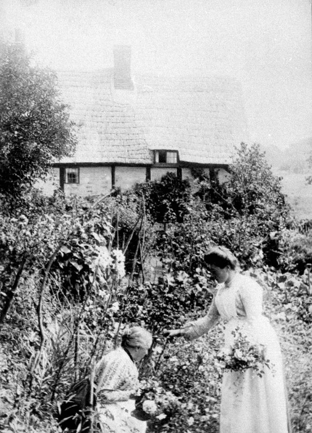 Avon Ford Cottage garden, Hampton Lucy. Two women with flowers.  1900s |  IMAGE LOCATION: (Warwickshire County Record Office)