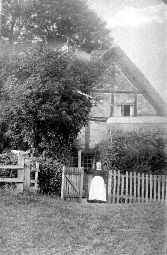 Avon Ford Cottage with woman at gate, Hampton Lucy.  1900s |  IMAGE LOCATION: (Warwickshire County Record Office)