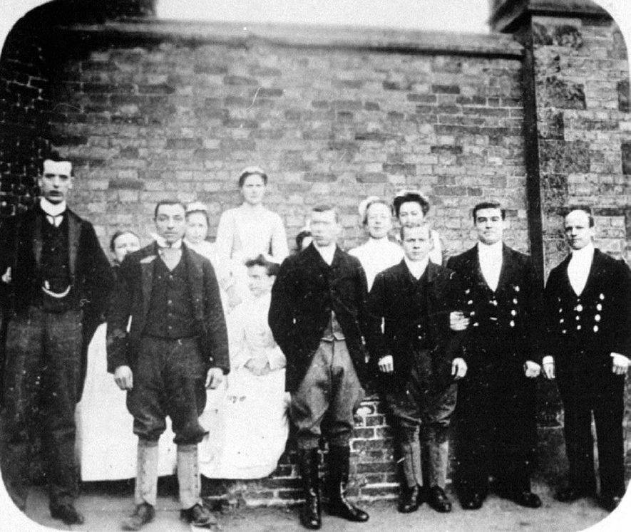 Charlecote Park.  The servants, including James Passmore, groom to the Lucy family 1900s. |  IMAGE LOCATION: (Warwickshire County Record Office) PEOPLE IN PHOTO: Passmore, James