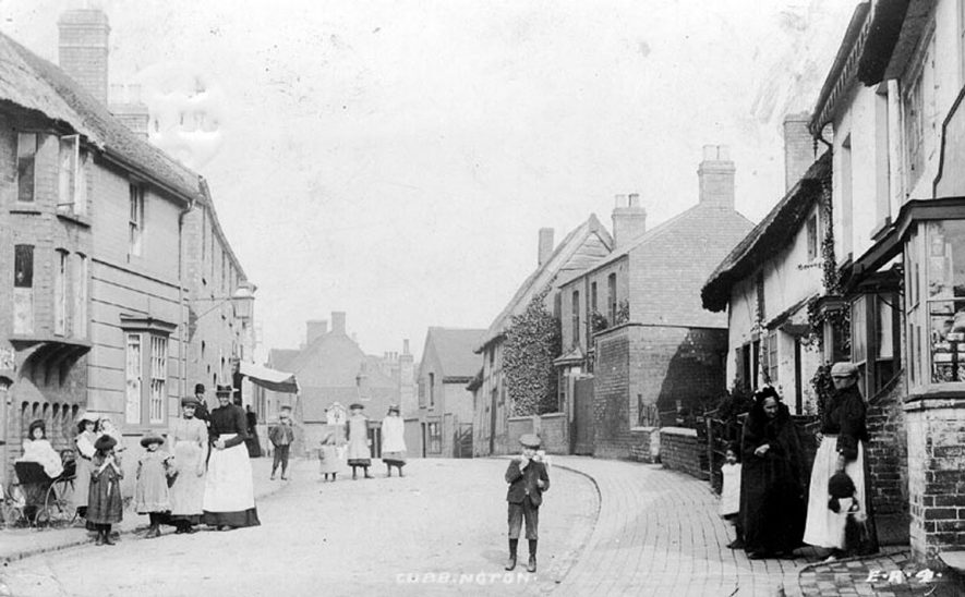 Queen Street, Cubbington. Children and adults are seen standing in the street.  1900s |  IMAGE LOCATION: (Warwickshire County Record Office)