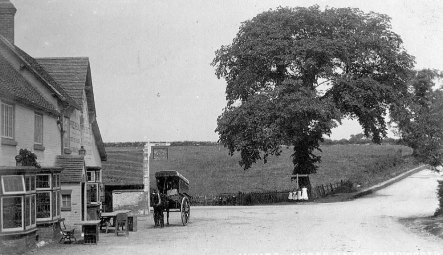 The White Horse Inn, Curdworth, with a stationary horse-drawn delivery van standing outside.  1900s |  IMAGE LOCATION: (Warwickshire County Record Office)