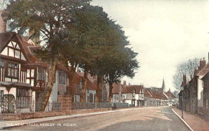 Houses and Yew Trees in High Street, Henley in Arden.  1910s    IMAGE LOCATION: (Warwickshire County Record Office)