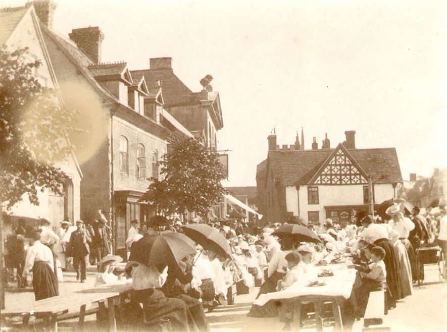 A street party probably for a coronation in Henley in Arden.  1910s |  IMAGE LOCATION: (Warwickshire County Record Office)