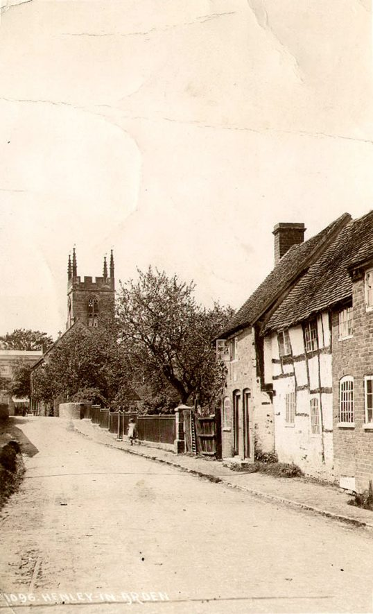 Cottages with the Church in the background. Small bridge. Henley in Arden.  1910s [It has been suggested this photograph will have been taken pre 1912.] |  IMAGE LOCATION: (Warwickshire County Record Office)