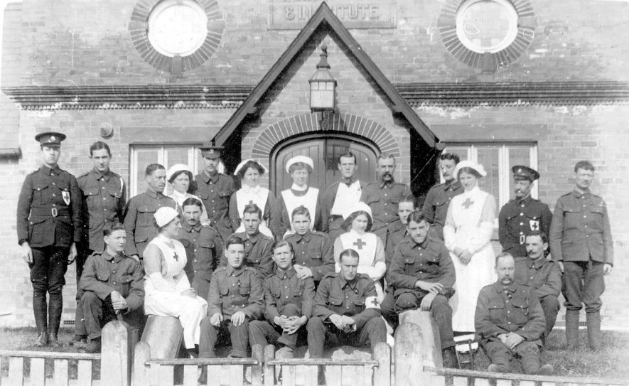 Henley in Arden Red Cross Hospital.  A group of nurses and R.A.M.C. staff.  1915 |  IMAGE LOCATION: (Warwickshire County Record Office)