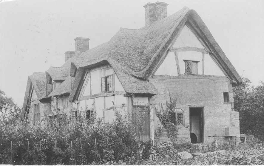 The Old Manor House, Dorsington, thatched and timber-framed.  1900s |  IMAGE LOCATION: (Warwickshire County Record Office)