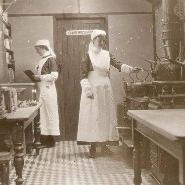 Henley in Arden.  Red Cross Hospital nurses in ward kitchen