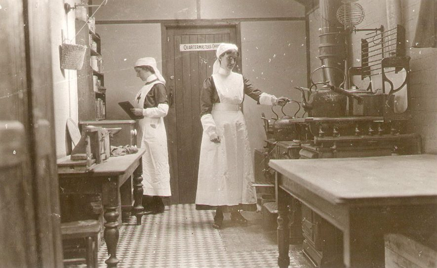 Henley in Arden Red Cross Hospital, nurses in a ward kitchen.  1915 |  IMAGE LOCATION: (Warwickshire County Record Office)
