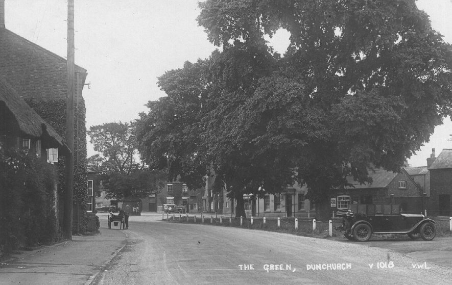 The Green, Dunchurch with old cottages and cars.  1920s |  IMAGE LOCATION: (Warwickshire County Record Office)