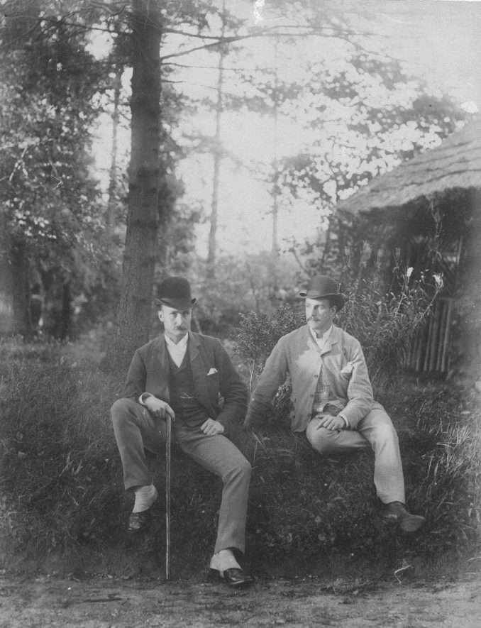 Dr. Percy A. Roden & Horace H. Roden, of the Indian Public Works Department, seated on grassy bank by summer house in Dorsington.  1900s |  IMAGE LOCATION: (Warwickshire County Record Office) PEOPLE IN PHOTO: Roden, Horace H, Roden, Dr Percy A, Roden as a surname