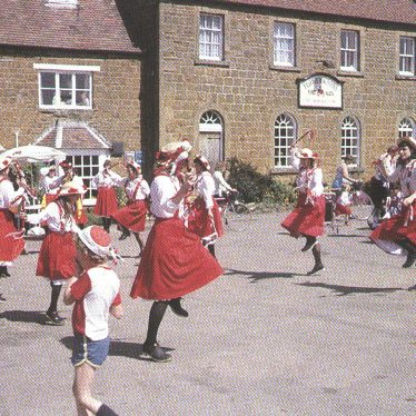 Ilmington.  Clog dancers in front of The Howard Arms