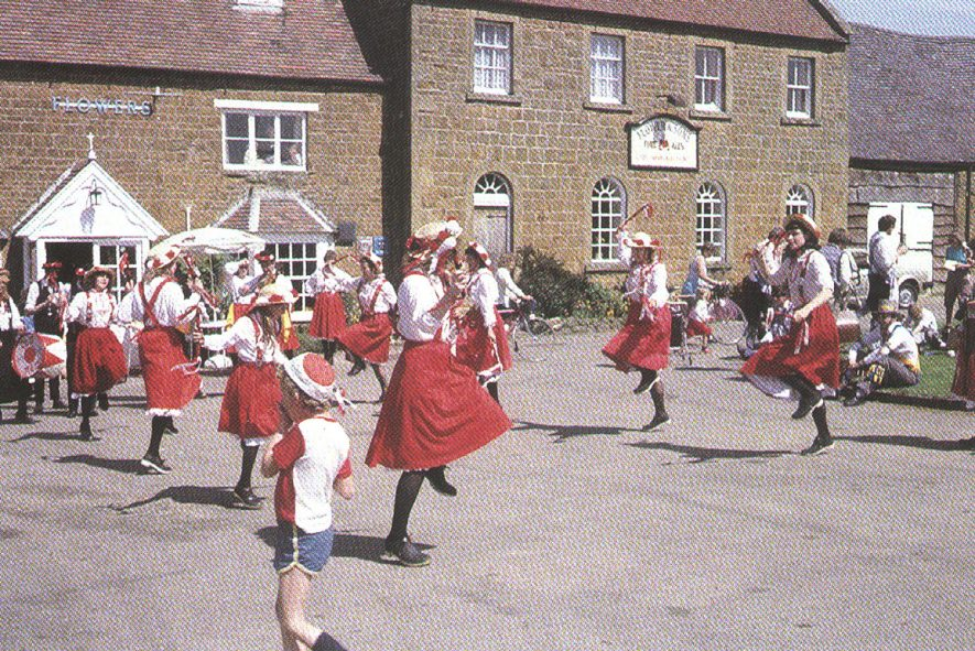 Clog dancers performing in front of The Howard Arms, Ilmington.  1980s |  IMAGE LOCATION: (Warwickshire County Record Office)