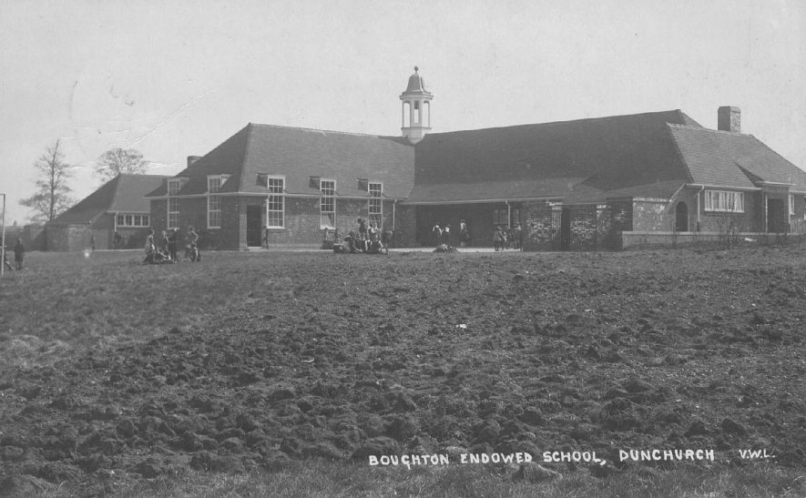 Boughton Endowed School building and some pupils, Dunchurch.  1920s |  IMAGE LOCATION: (Warwickshire County Record Office)