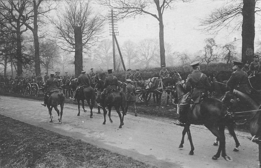 Cavalry with horses and gun carriages on road outside village, Dunchurch.  1910s |  IMAGE LOCATION: (Warwickshire County Record Office)