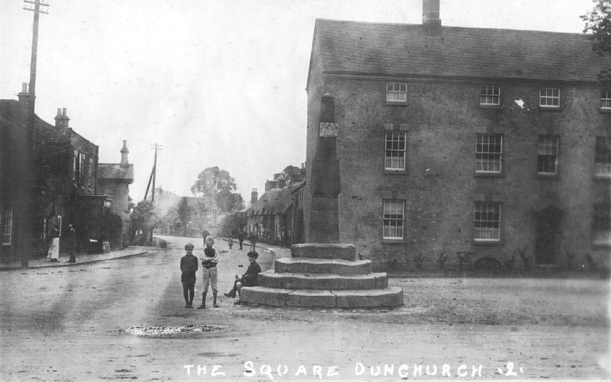 The Square, Dunchurch. Children standing beside broken Market Cross.  1900s |  IMAGE LOCATION: (Warwickshire County Record Office)