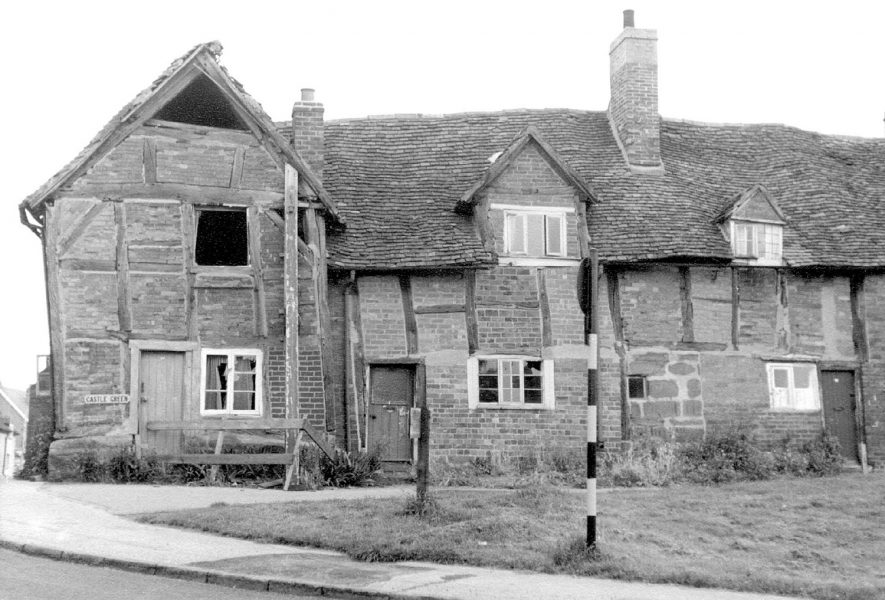 Derelict timbered cottages on Castle Green, Kenilworth.  1965    IMAGE LOCATION: (Warwickshire County Record Office)
