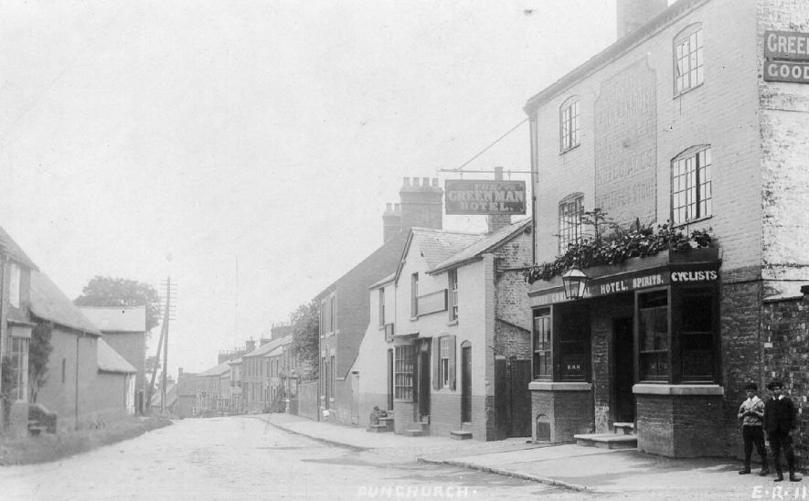 Street with cottages, shop and The Green Man Hotel, Dunchurch.  1900s |  IMAGE LOCATION: (Warwickshire County Record Office)