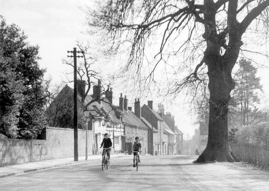 Two boys on their bicycles in High Street, Kenilworth.  Circa 1947 |  IMAGE LOCATION: (Warwickshire County Record Office)