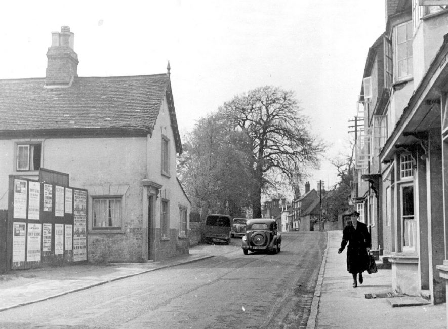 High Street, Kenilworth looking West from centre.  Car and woman pedestrian.  1947 |  IMAGE LOCATION: (Warwickshire County Record Office)