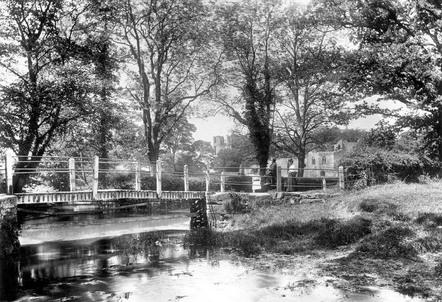 Bridge & ford over Inchford Brook, Kenilworth.  Castle in distance.  Three figures.  1892 |  IMAGE LOCATION: (Warwickshire County Record Office)