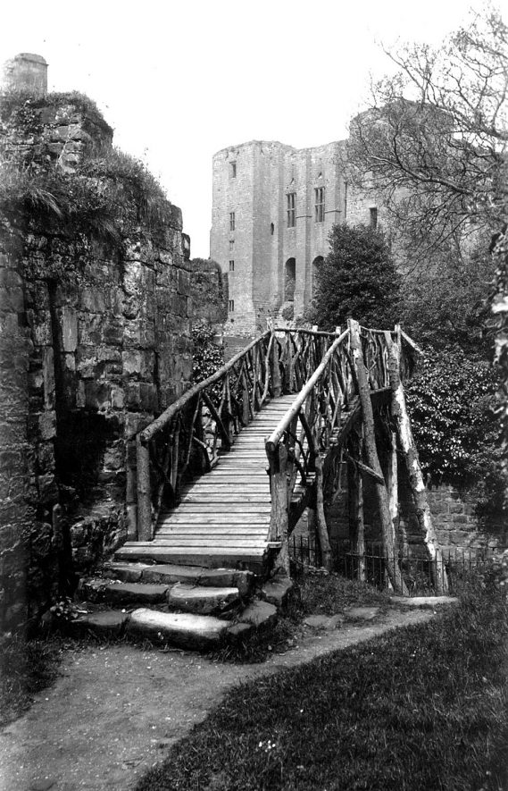 Caesar's Tower at Kenilworth Castle from the south east, showing a rustic bridge centre, Kenilworth.  1938-40 |  IMAGE LOCATION: (Warwickshire County Record Office)