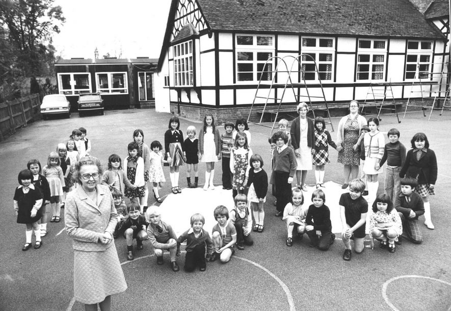Teachers and children outside Ladbroke School in 1976. |  IMAGE LOCATION: (Warwickshire County Record Office)