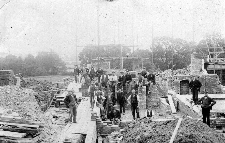 Building site in Dunchurch with group of workers.  1900s |  IMAGE LOCATION: (Warwickshire County Record Office)