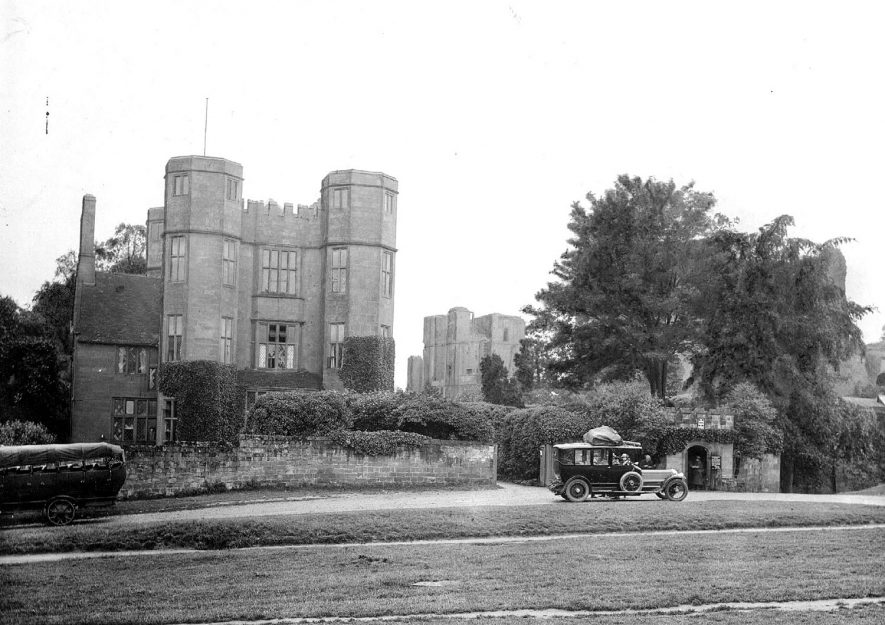 Kenilworth Castle gatehouse from the North.  Motor hearse on road.  1920s |  IMAGE LOCATION: (Warwickshire County Record Office)