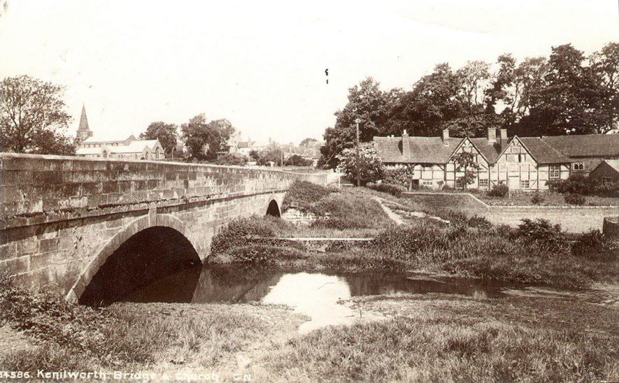 The bridge, St Nicholas church and timbered houses, Bridge Street, Kenilworth.  1900s |  IMAGE LOCATION: (Warwickshire County Record Office)
