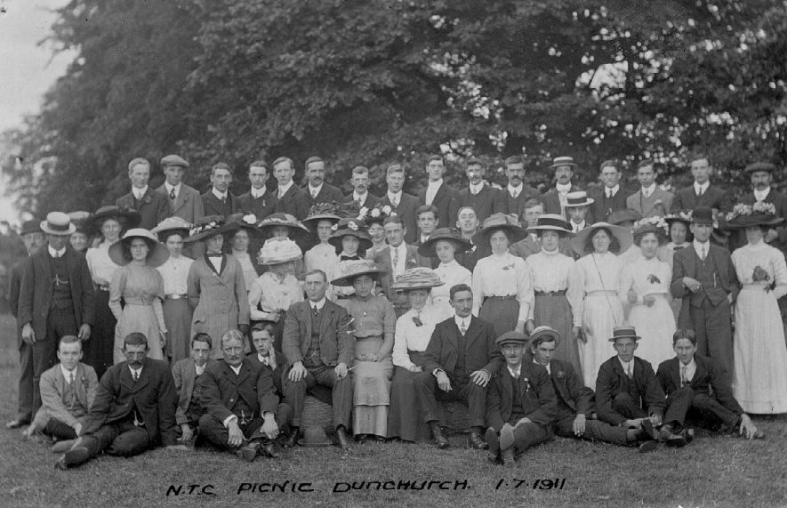 Group of men and women at the N.T.C. picnic in Dunchurch.  1 July 1911 |  IMAGE LOCATION: (Warwickshire County Record Office)