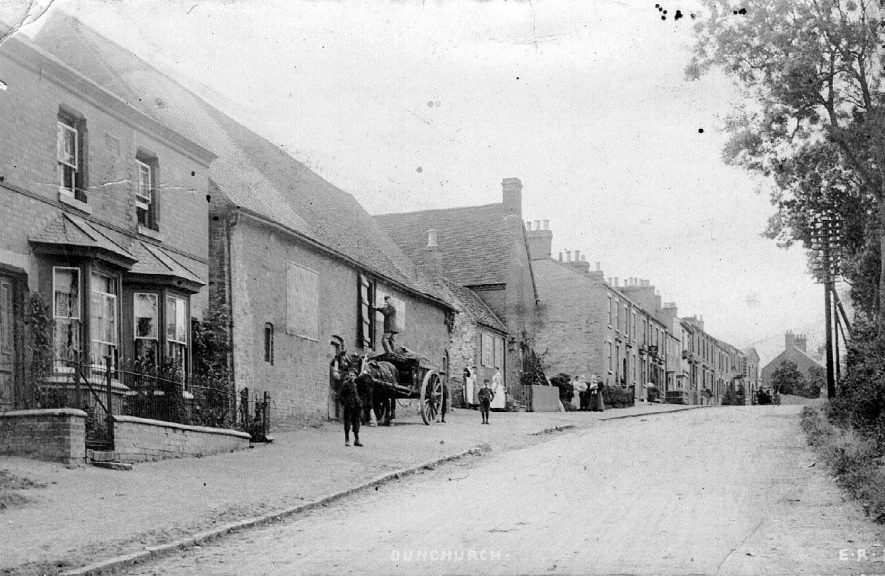 Houses in Daventry Road, Dunchurch. Also showing horse and cart from Pridmores, coal and corn merchants.  1900s |  IMAGE LOCATION: (Warwickshire County Record Office)
