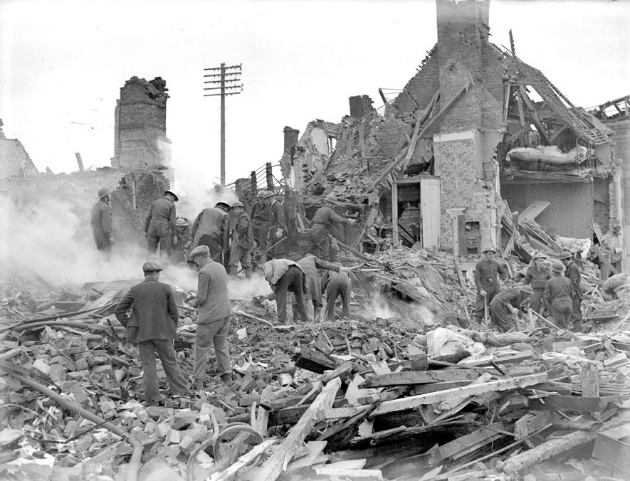 Workers sifting through bomb damage in Warwick Road, Kenilworth.  1940s |  IMAGE LOCATION: (Warwickshire County Record Office)
