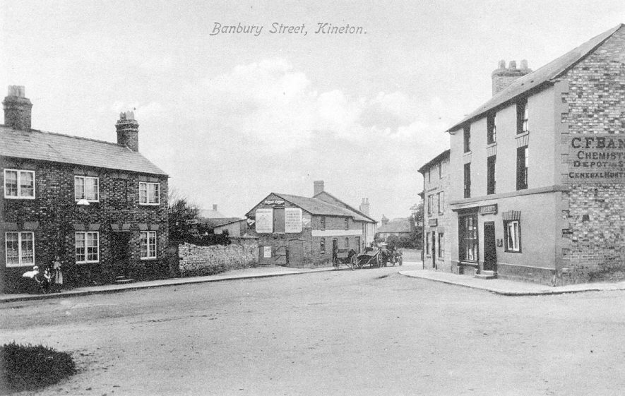 Cottages and a chemist's shop in Banbury Street, Kineton. A horse and cart is also pictured.  1900s |  IMAGE LOCATION: (Warwickshire County Record Office)