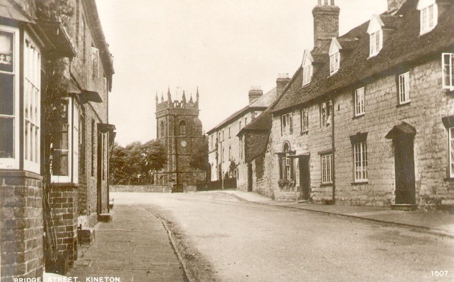 Bridge Street, Kineton, showing cottages and parish church tower.   1910s |  IMAGE LOCATION: (Warwickshire County Record Office)